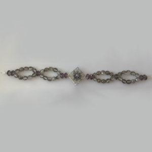 Tocado joya novia cristales checos grises camafeo plateado con flor de abalorio en el centro y cristal checo gris